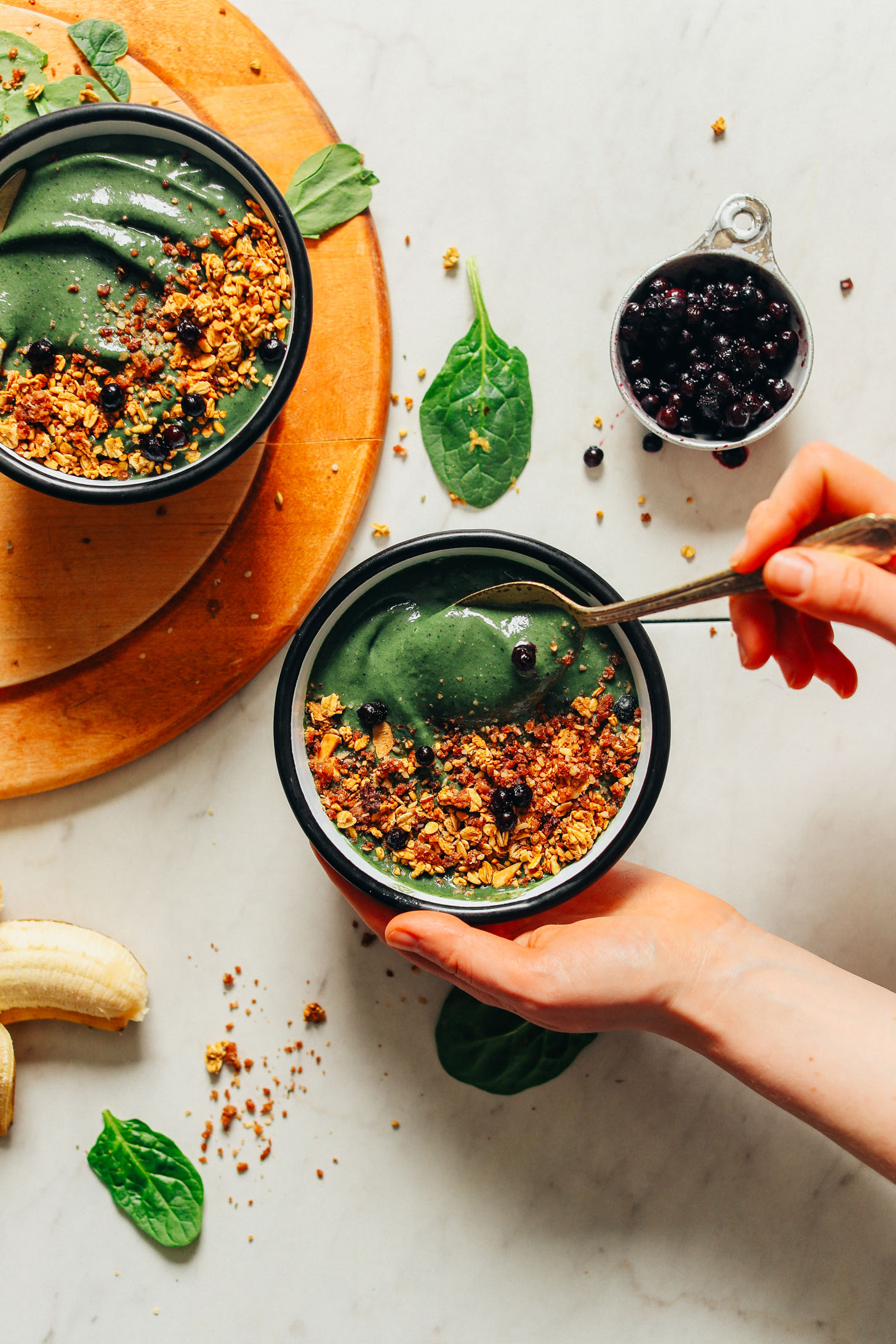 Grabbing a spoonful of our vegan Peanut Butter Banana Super Green Smoothie Bowl made with spirulina