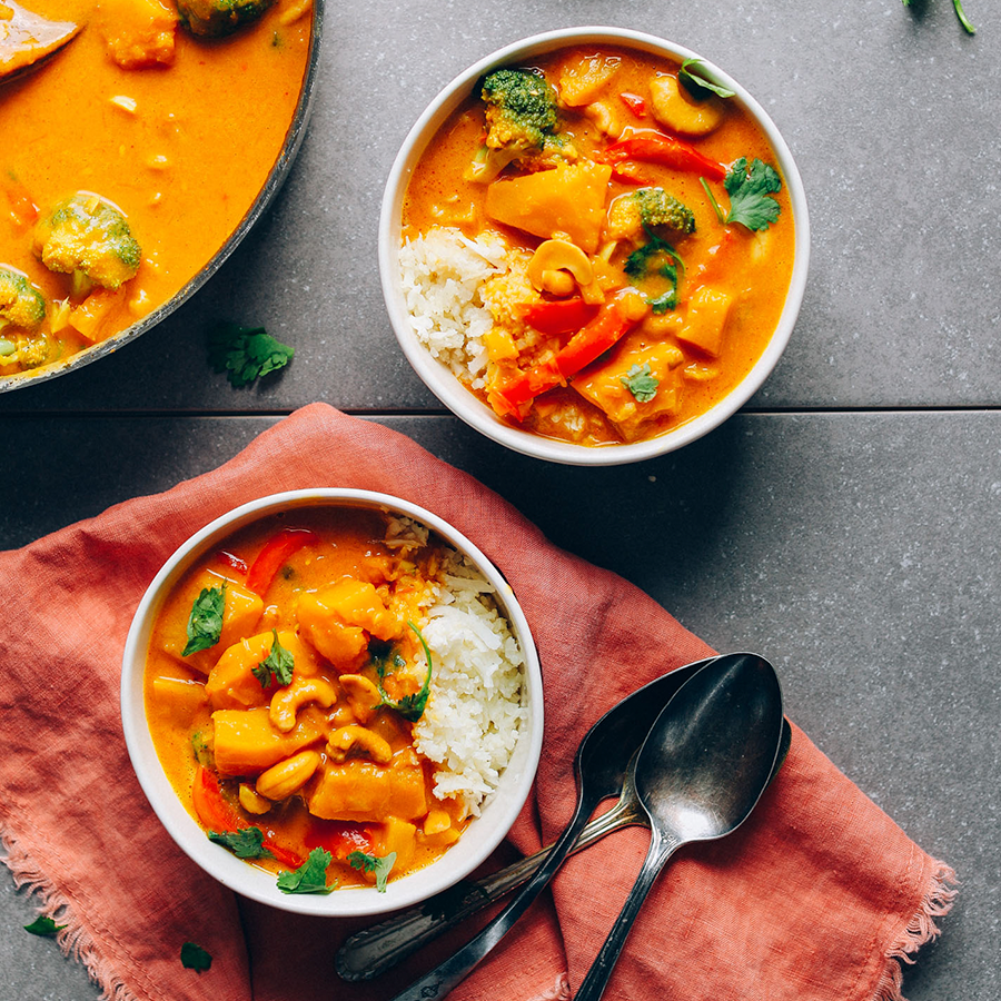 Bowls of Yellow Pumpkin Curry for our roundup of Make Ahead Plant-Based Meals