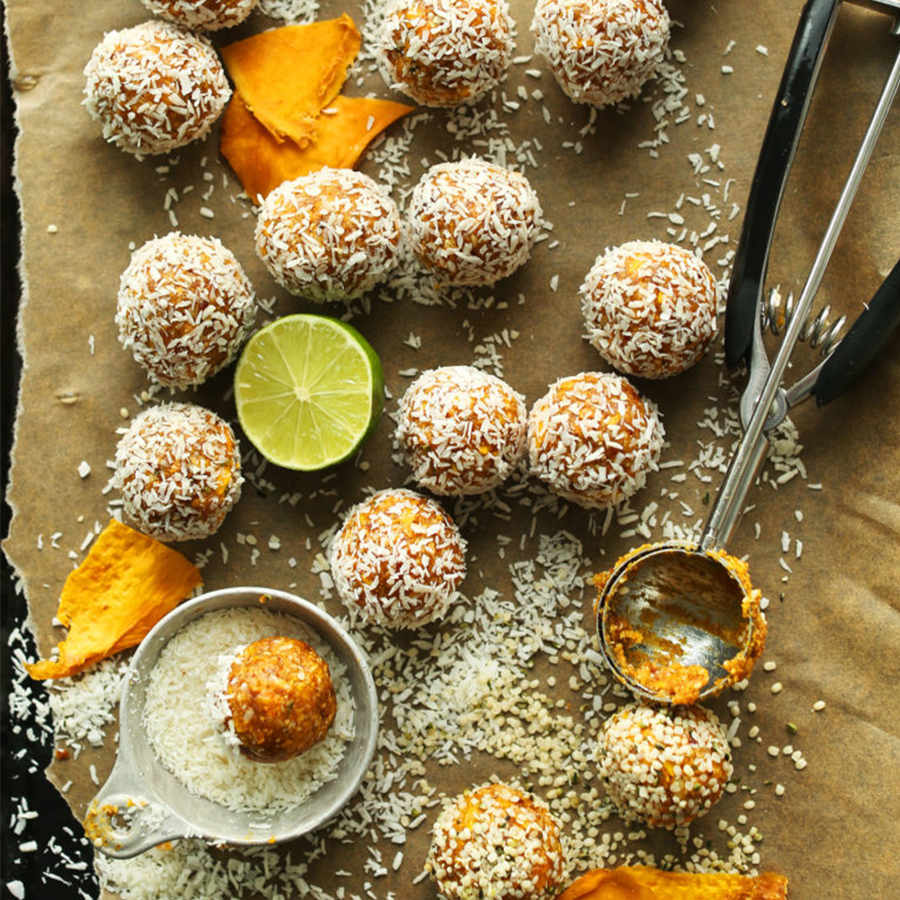Parchment-lined baking sheet filled with Mango Energy Bites for a Spring-Inspired plant-based recipe