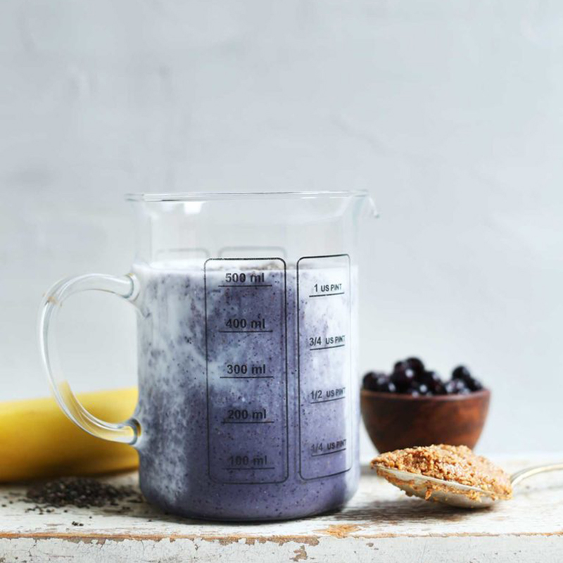 Liquid measuring glass filled with a Blueberry Smoothie for our Spring-Inspired Recipes roundup