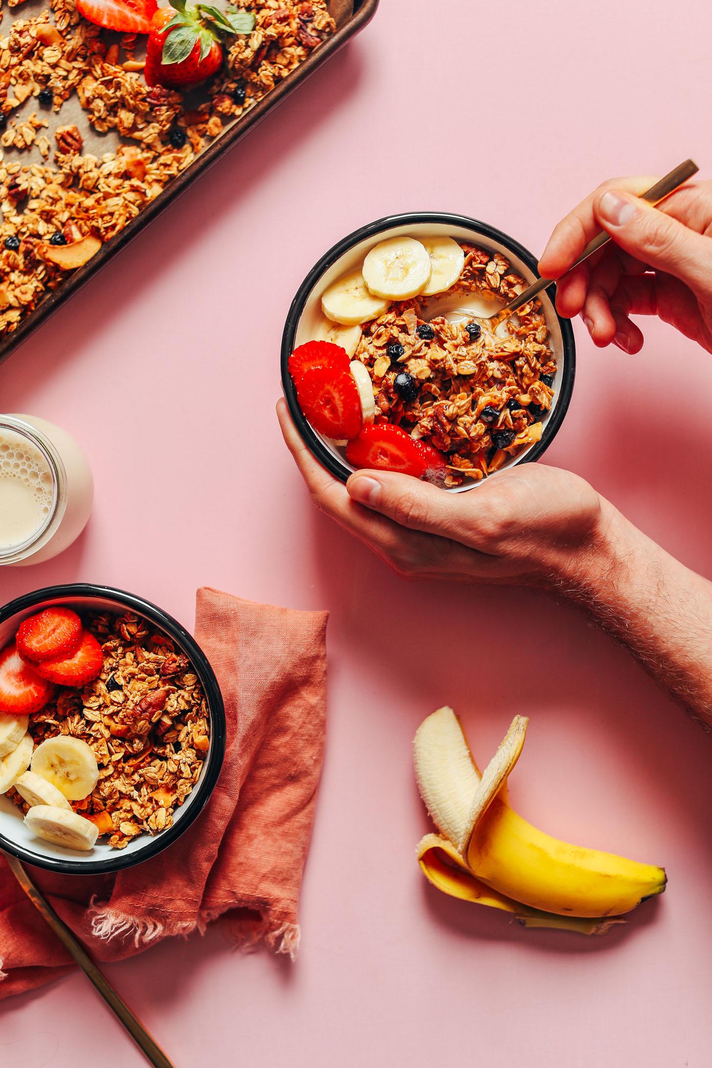 Using a spoon to grab a bite of granola for a gluten-free vegan breakfast