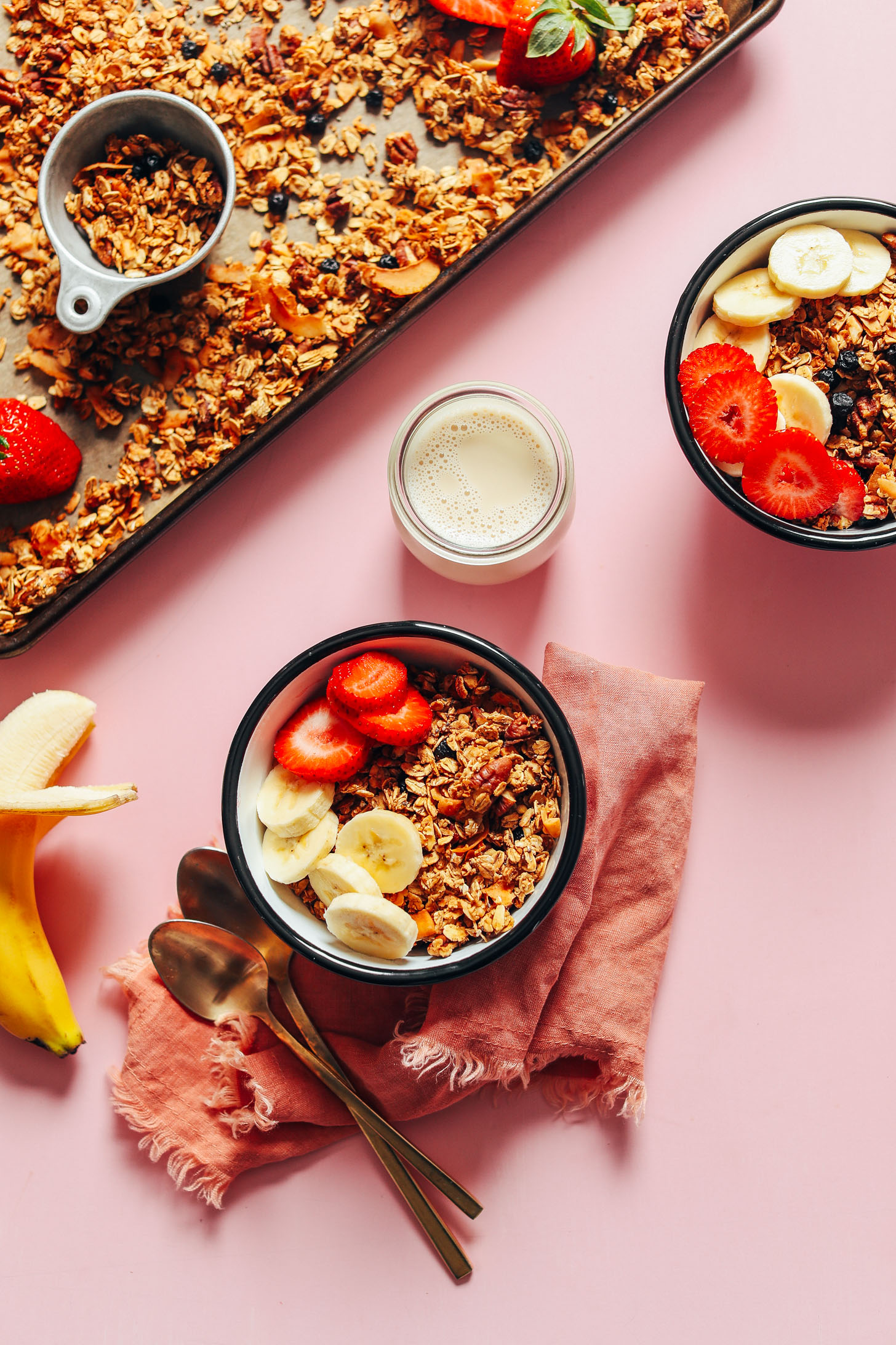 Breakfast bowls filled with crunchy naturally sweet oil-free granola topped with fresh fruit