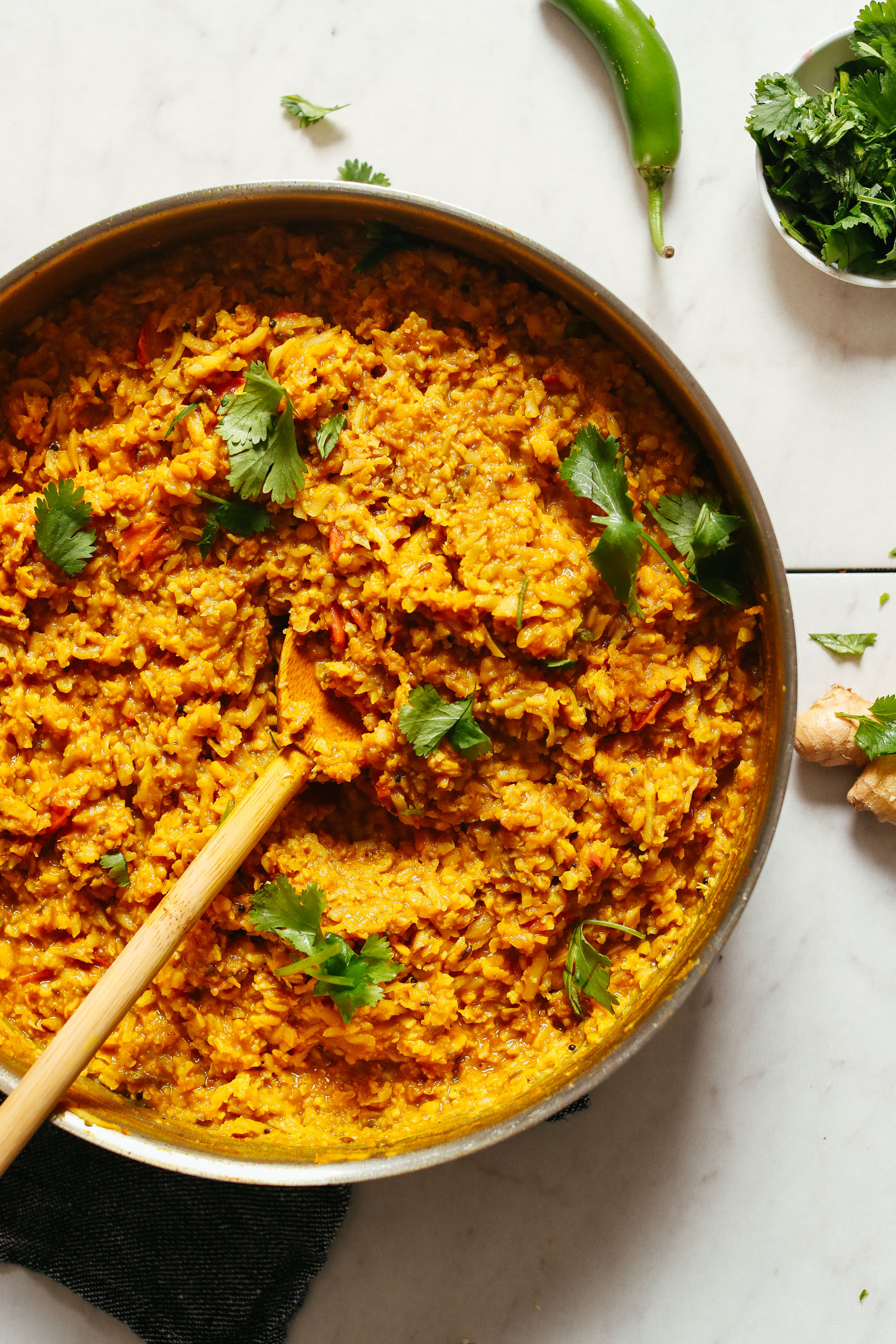 Stirring a pot of gluten-free vegan Cauliflower Rice Kitchari