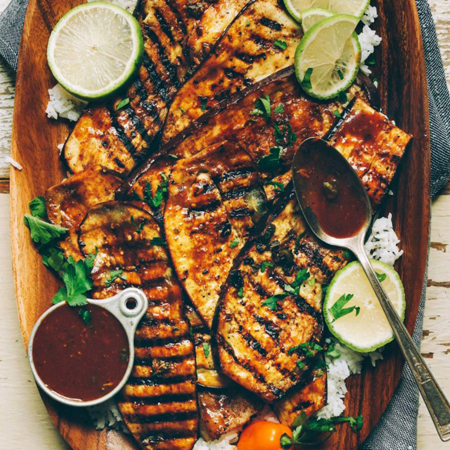 Wood platter filled with delicious Jamaican Jerk Grilled Eggplant
