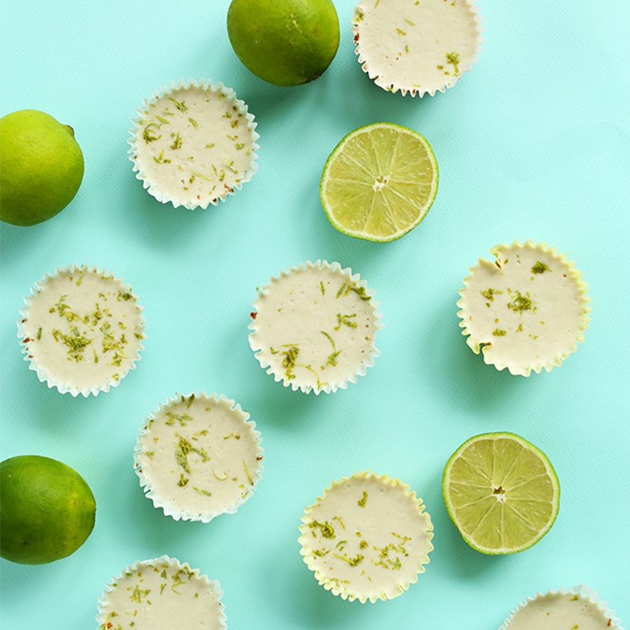 Mini Vegan Key Lime Pies on a blue background for our 24 Spring-Inspired Recipes roundup