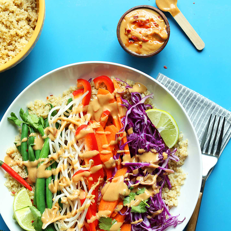 Bowls of Quinoa Gado Gado and peanut sauce for our roundup of Make Ahead Plant-Based Meals