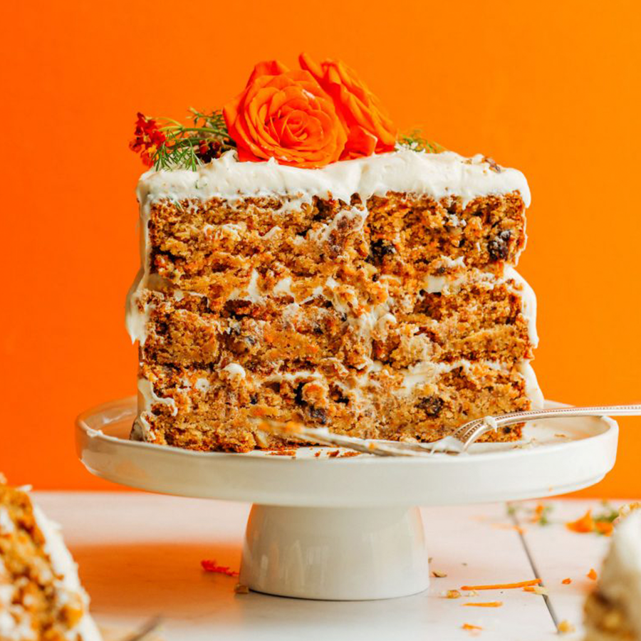 Carrot cake on a platter for our roundup of 12 Easy Vegan Easter Treat recipes
