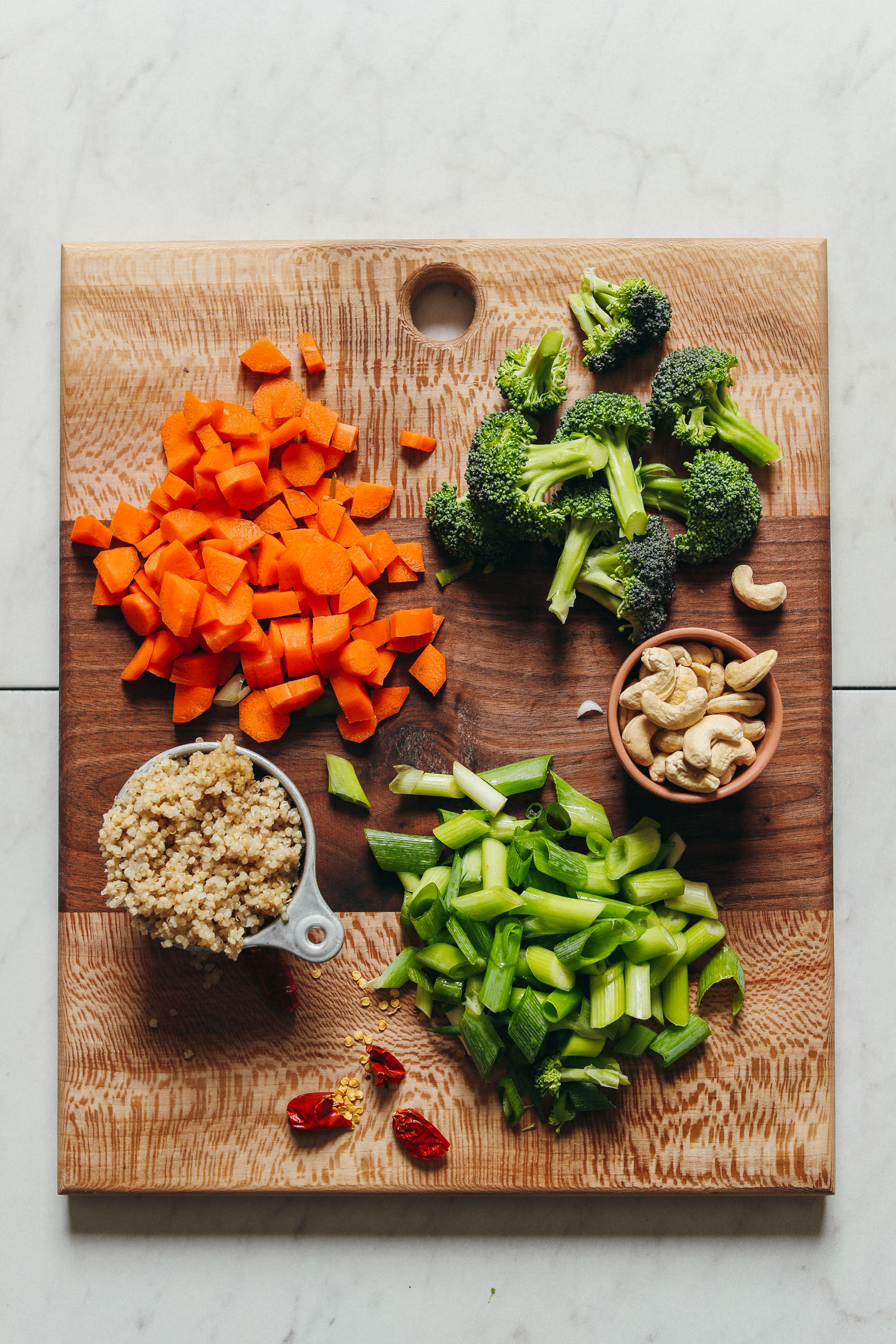 Ingredients for vegan quinoa fried rice on a cutting board