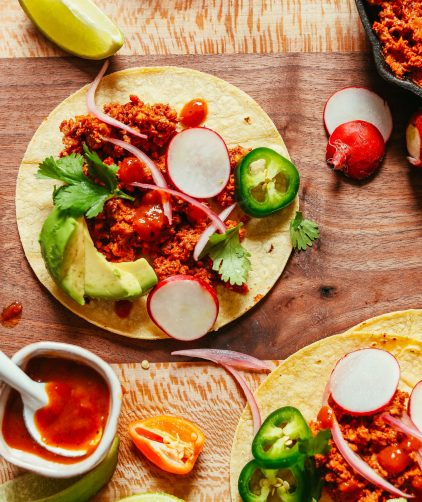 "Tortillas topped with amazing Vegan Taco ""Meat"" inspired by Mexican flavors"