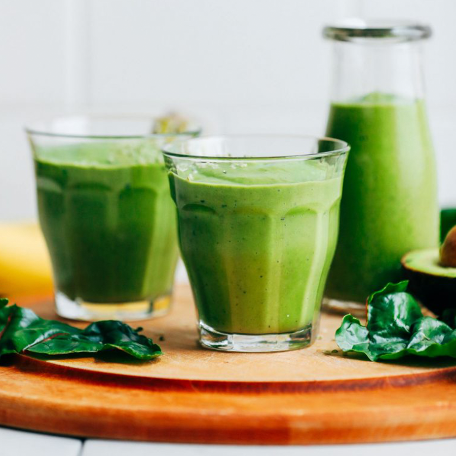 Glasses and mini milk jug of Creamy Avocado Green Smoothie for our roundup of Vegan Breakfast Recipes