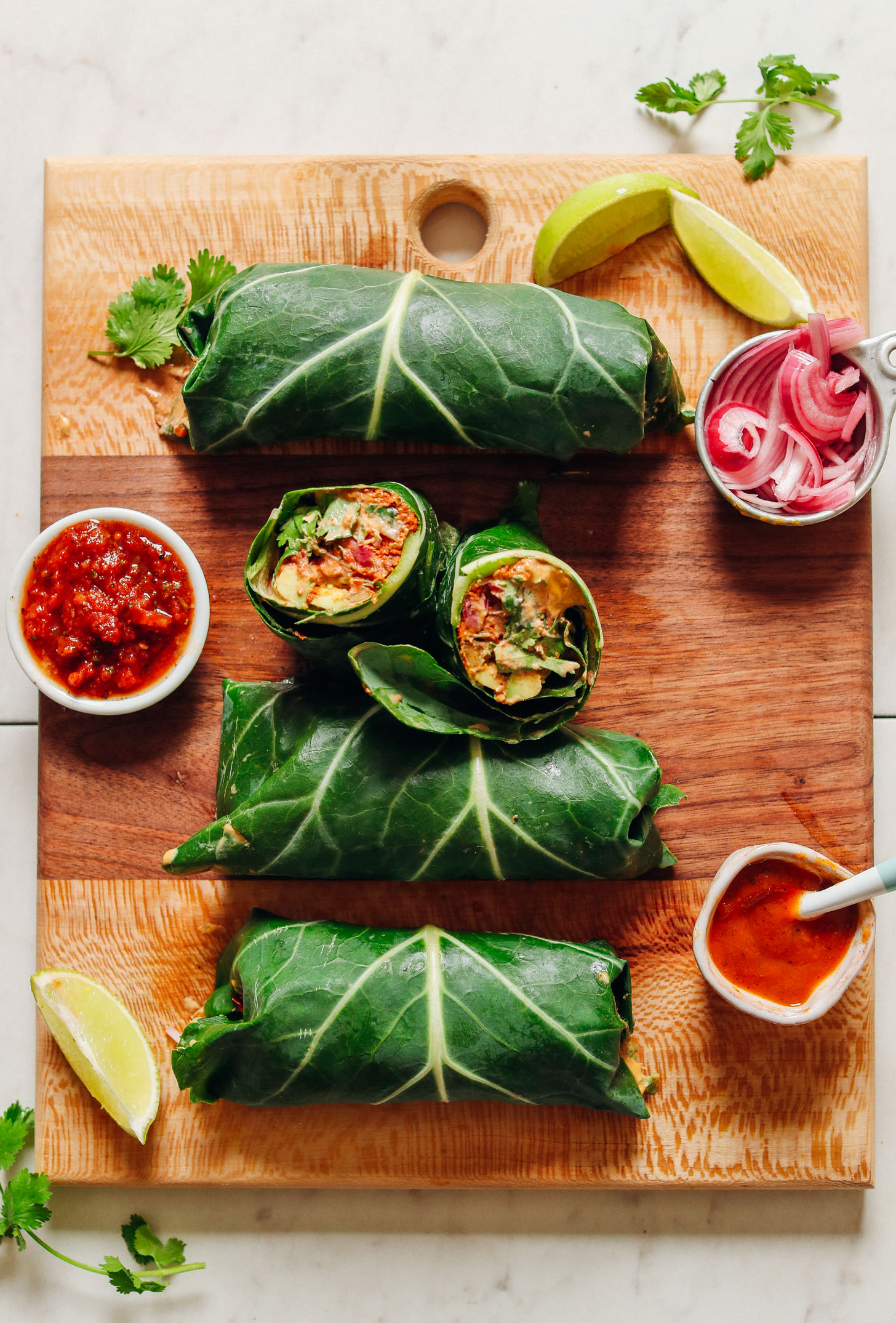 Wood cutting board with gluten-free Raw Vegan Burritos with Mexican-inspired flavor