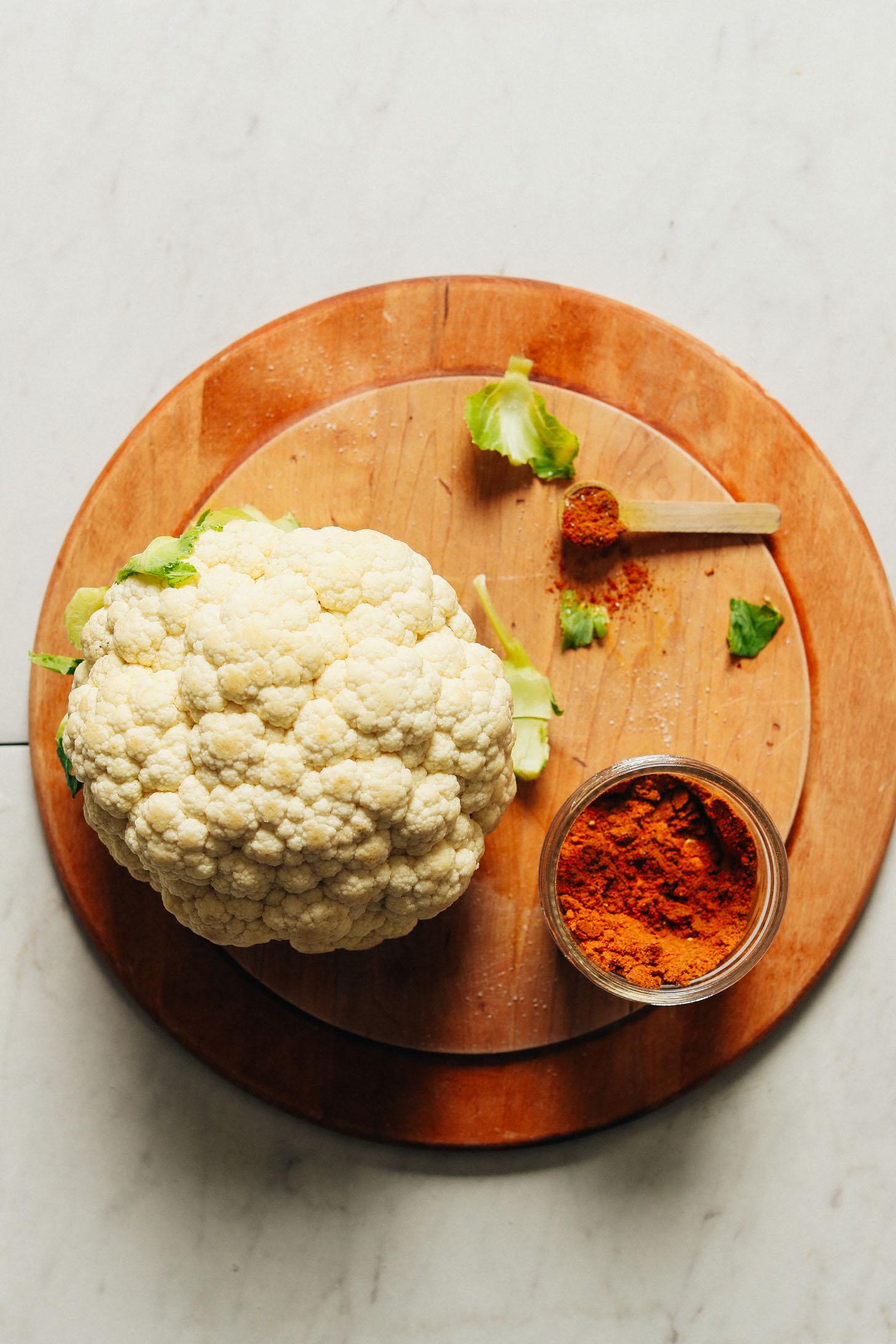 Wood cutting board with cauliflower and homemade Shawarma spice