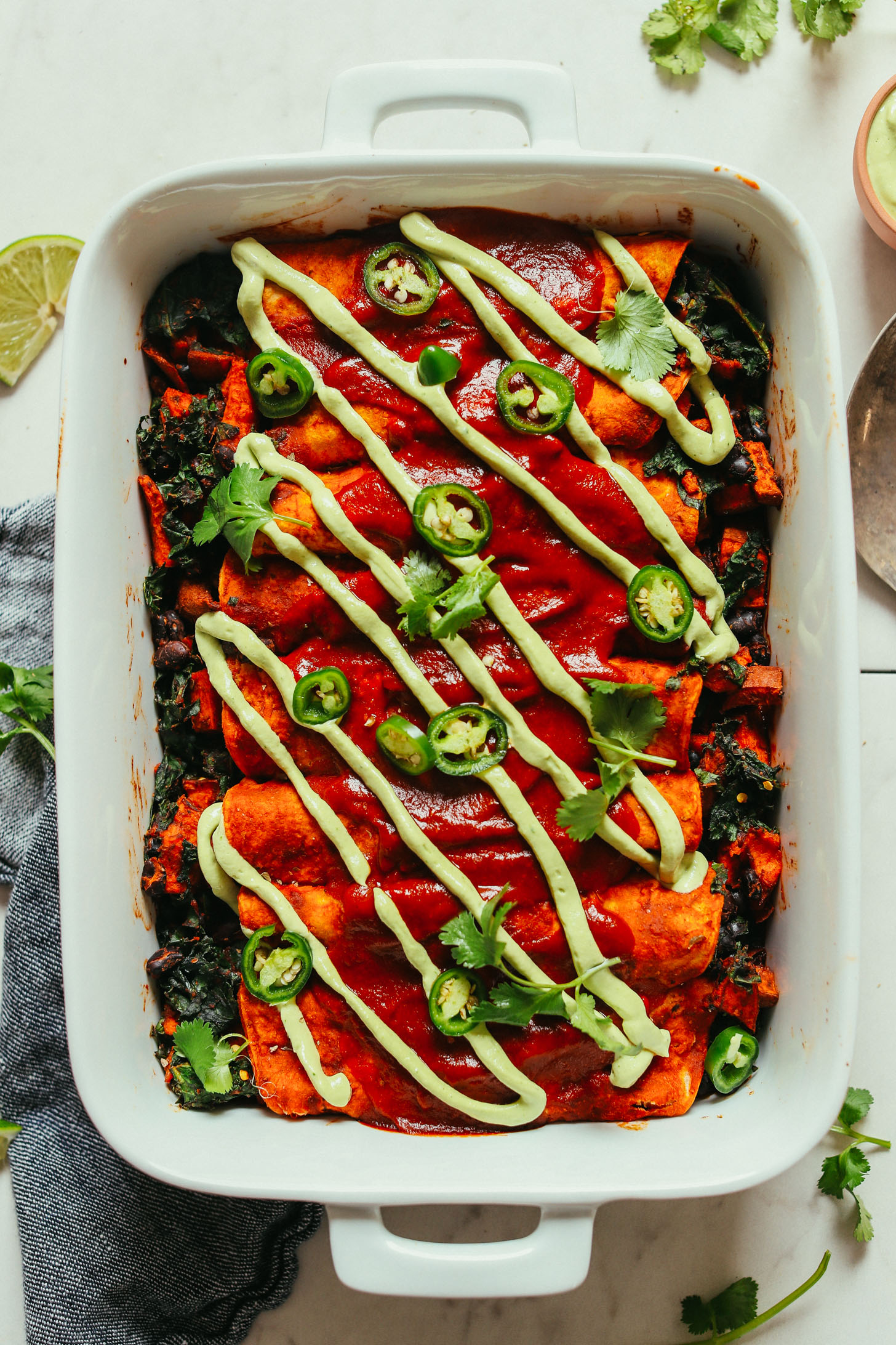 Baking Pan of gluten-free vegan Sweet Potato Black Bean Enchiladas for a satisfying plant-based meal