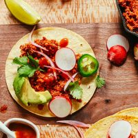 Cutting board with a taco made with our delicious Vegan Taco Meat recipe