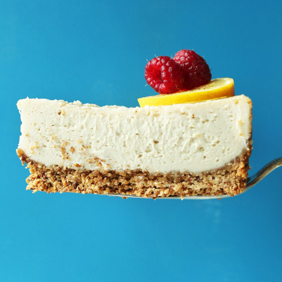 Slice of baked cheesecake on blue background