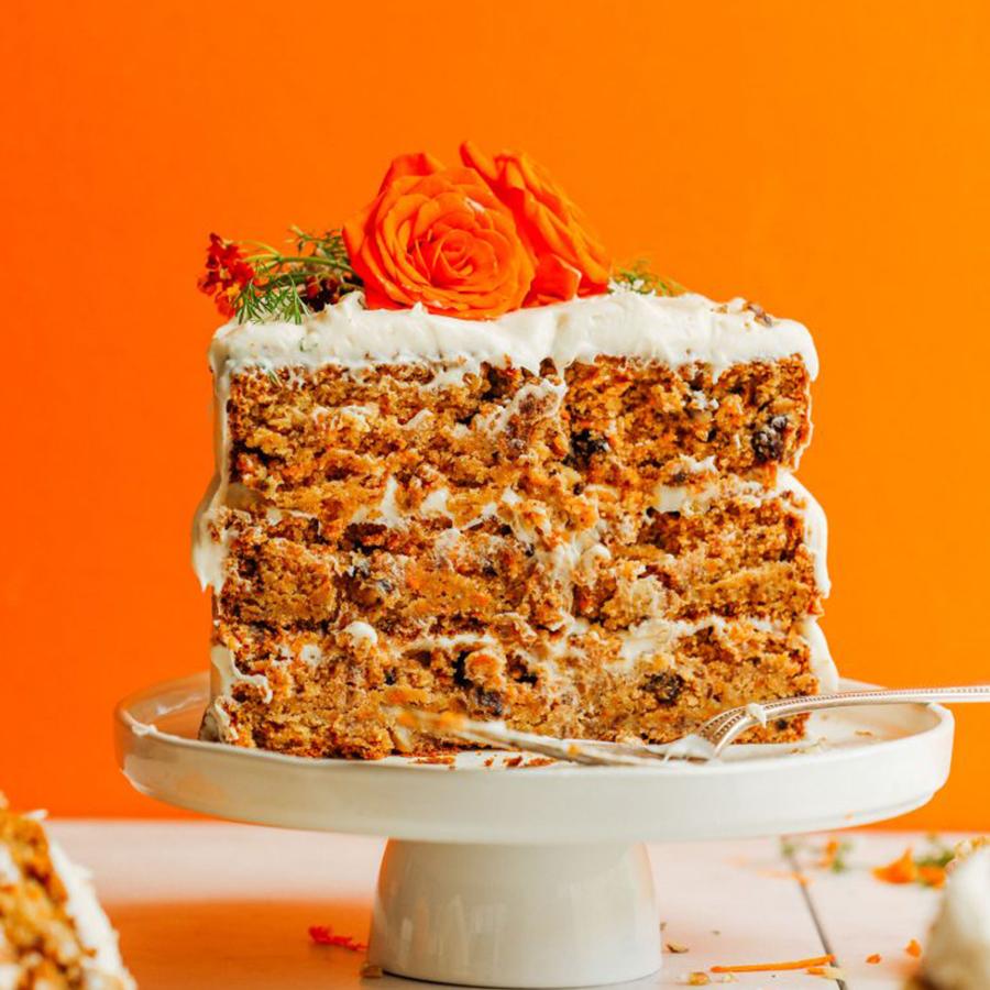 Slice of vegan gluten-free carrot cake on platter