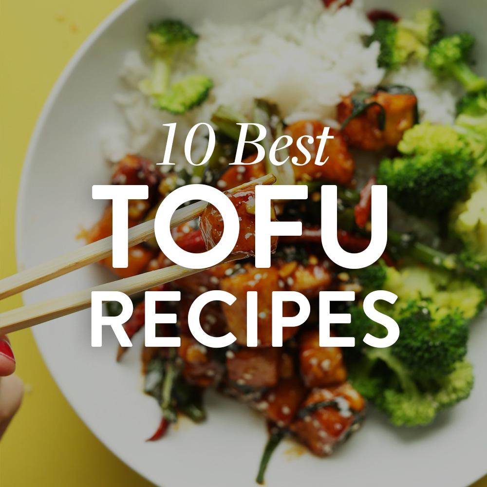 Chopsticks holding a piece of tofu for our 10 Best Tofu Recipes roundup