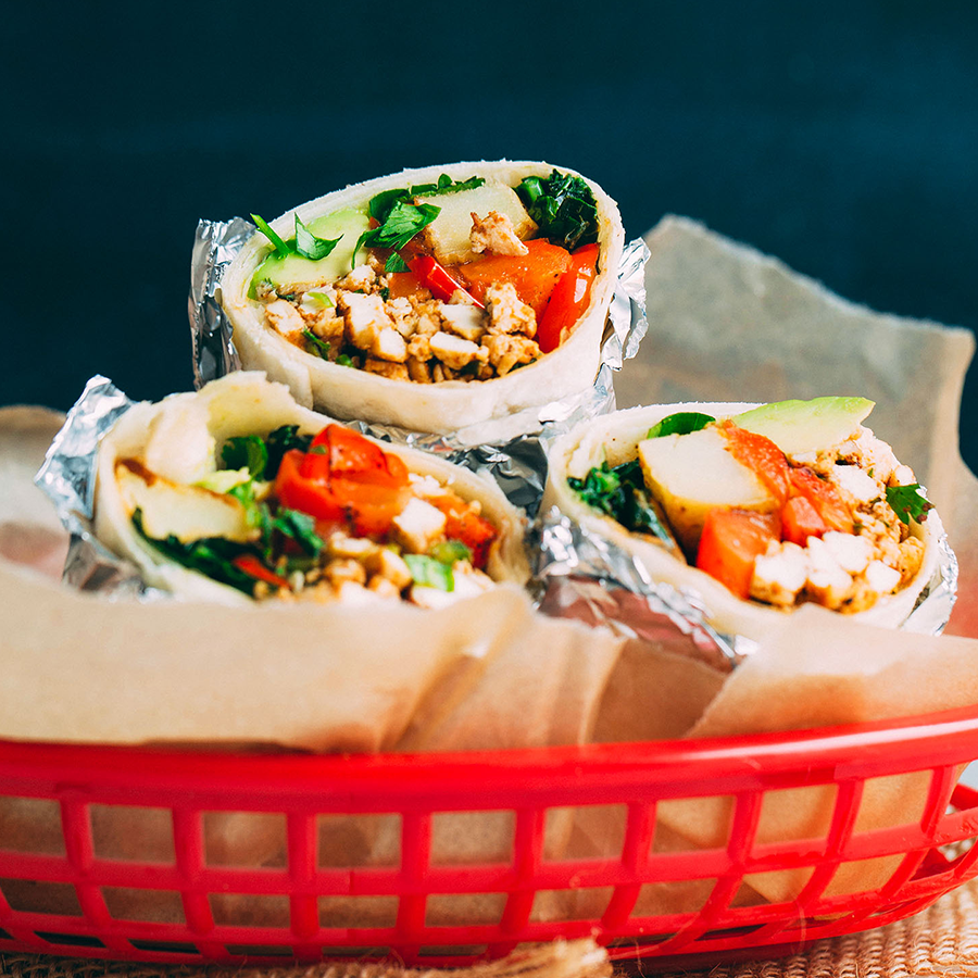 Basket of vegan breakfast burritos for our roundup of the Best Tofu Recipes