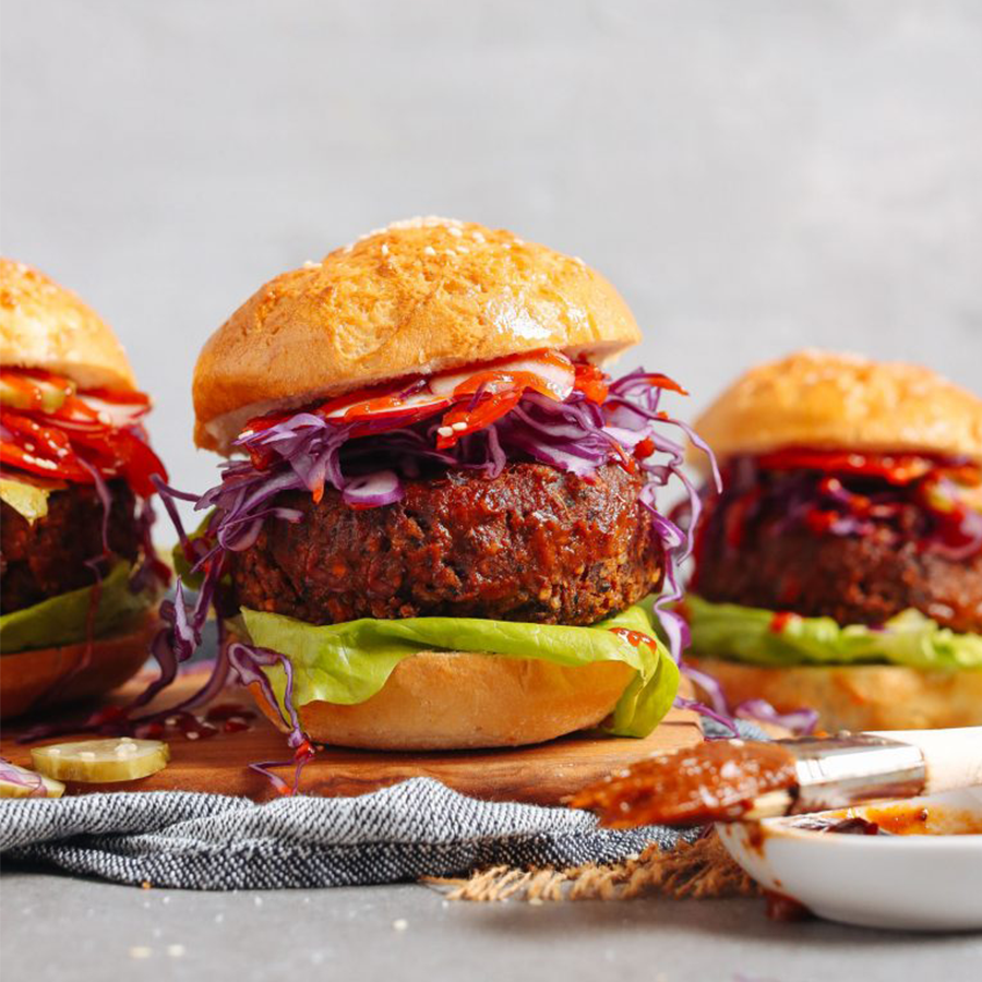 BBQ Black Bean Burgers on a wood cutting board