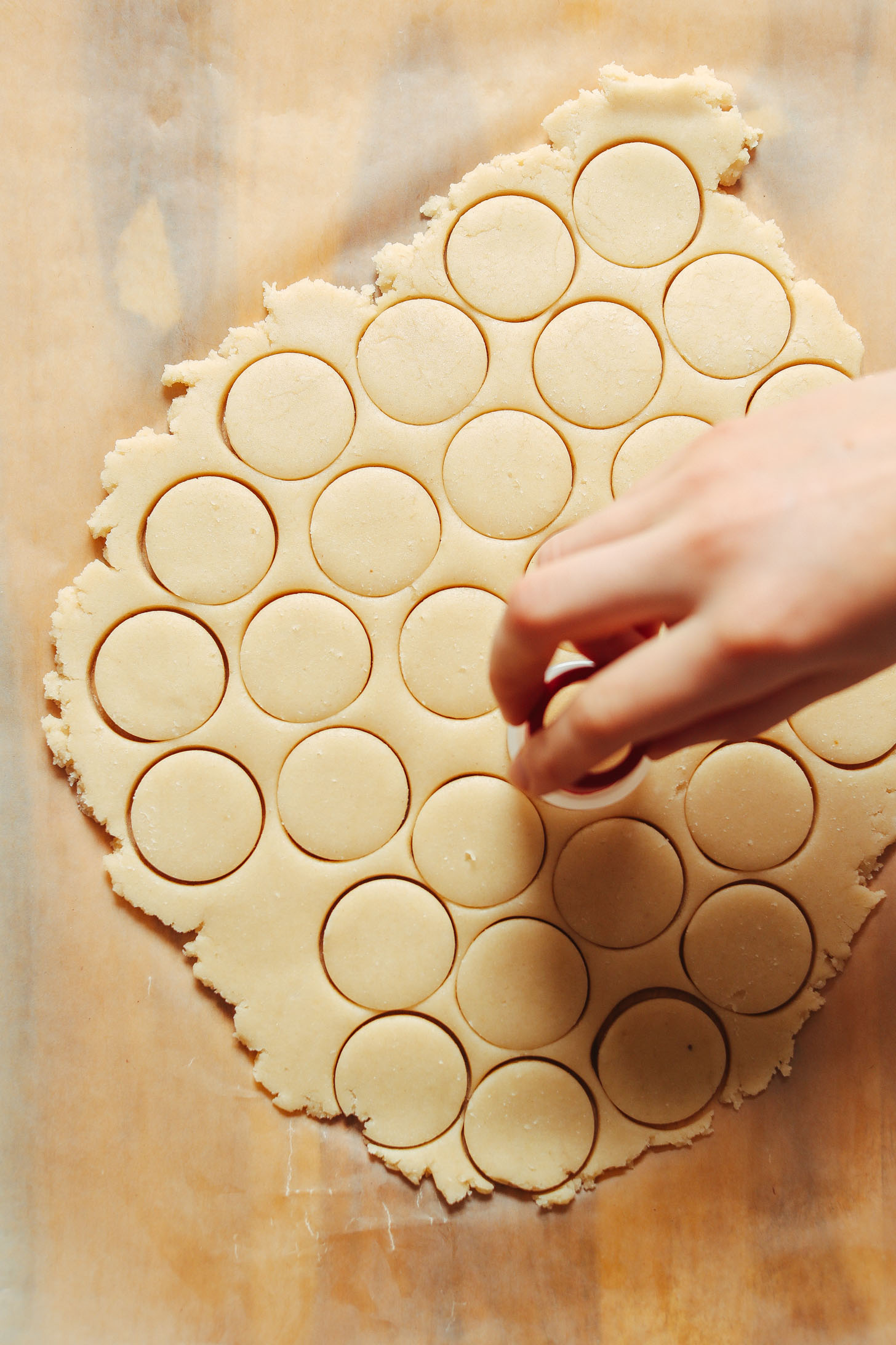 Using a small round cookie cutter to create vanilla wafers shapes