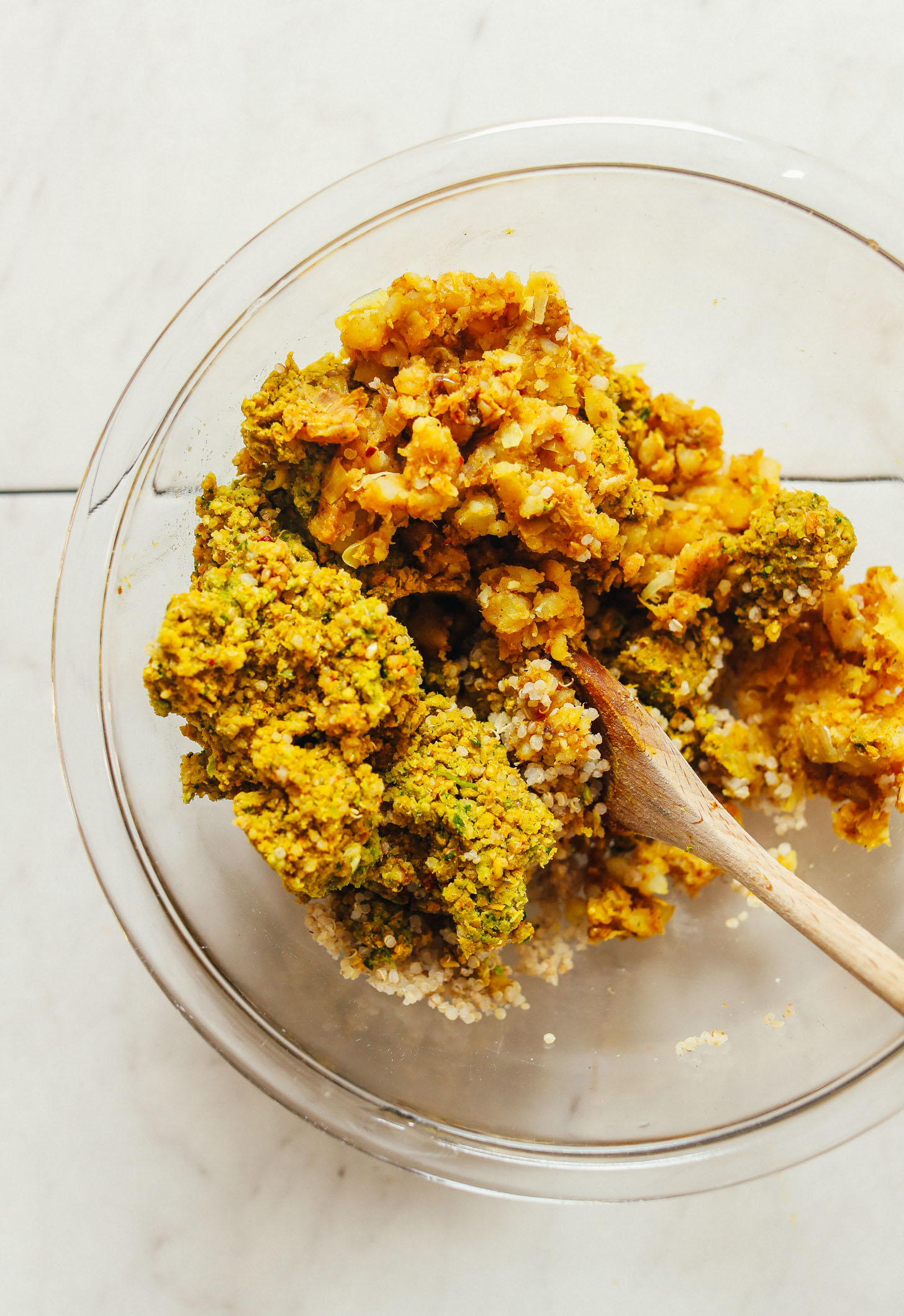 Stirring together ingredients for homemade vegan Curried Chickpea Burgers