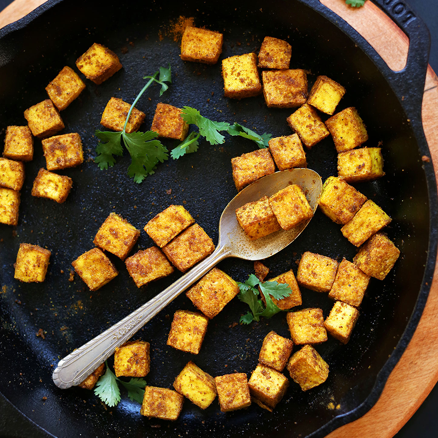 Cast iron skillet of curried tofu for our roundup of the 10 Best Tofu Recipes