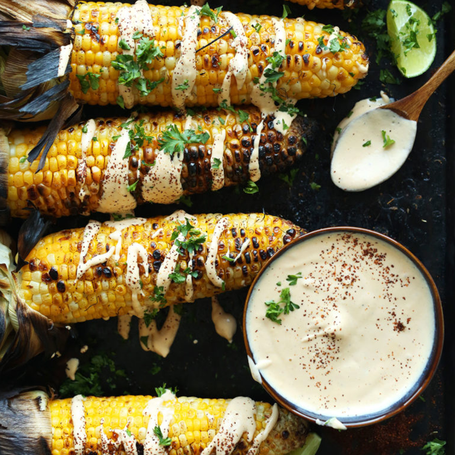 Ears of Grilled Corn and a bowl of Sriracha Aioli