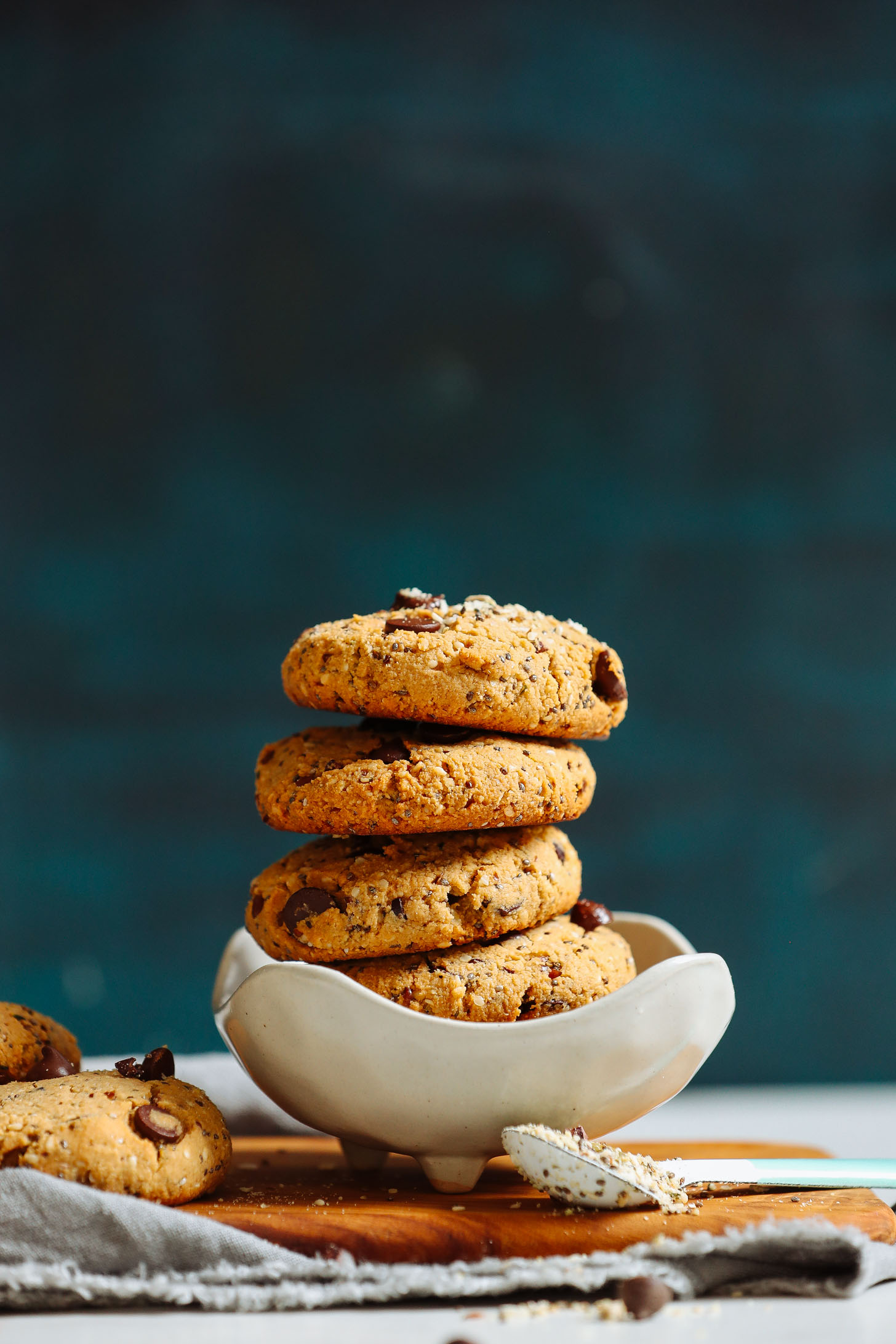 Homemade gluten-free vegan Trail Mix Cookies stacked in a bowl
