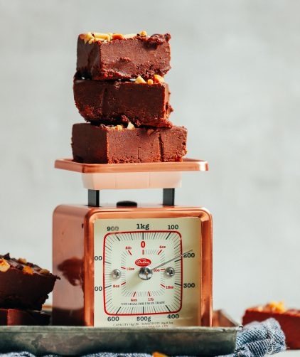 Vintage scale with a stack of 4-Ingredient Vegan Chocolate Peanut Butter Fudge
