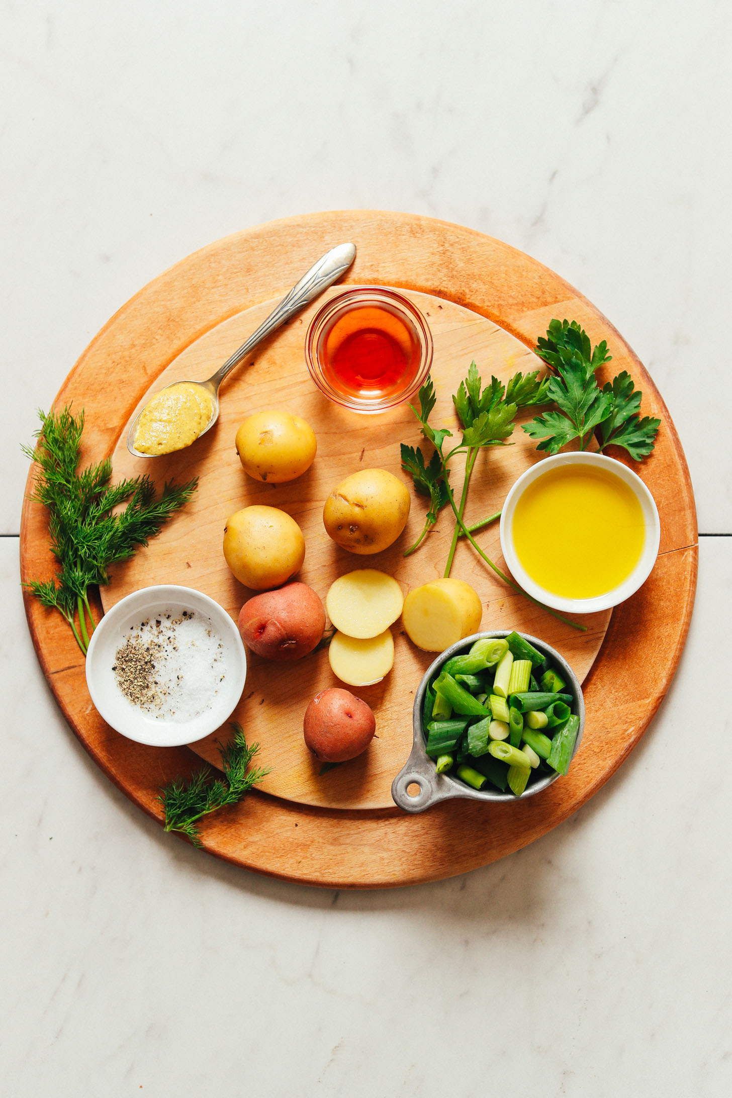 Cutting board filled with ingredients for making homemade French-Style Potato Salad