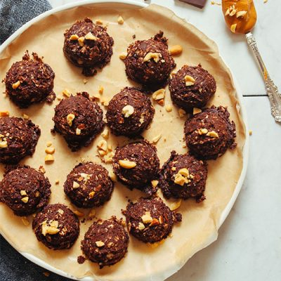 Parchment-lined plate of Vegan Chocolate Peanut Butter No Bake Cookies