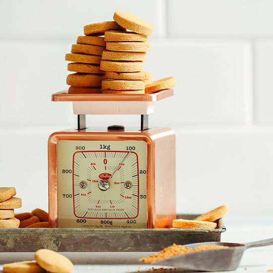 Batch of Vegan Vanilla Wafer Cookies resting on a vintage scale