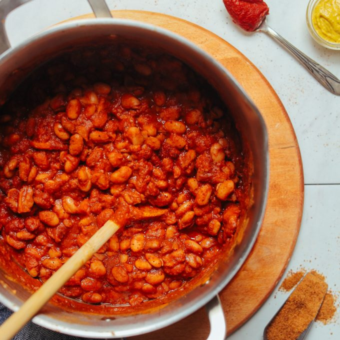 Stirring a big pot of our homemade vegan BBQ Baked Beans