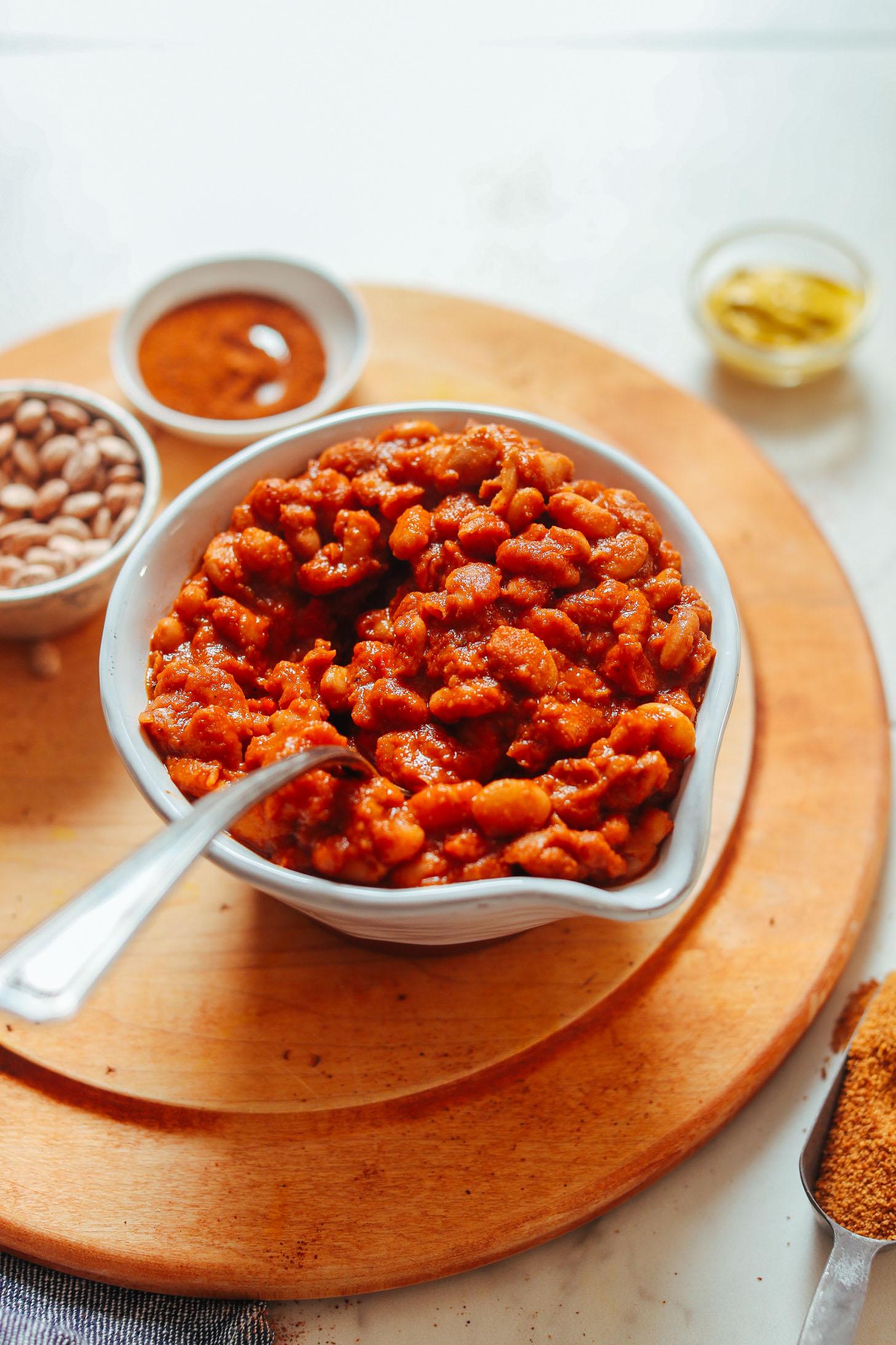 Grabbing a spoonful of vegan gluten-free BBQ Baked Beans
