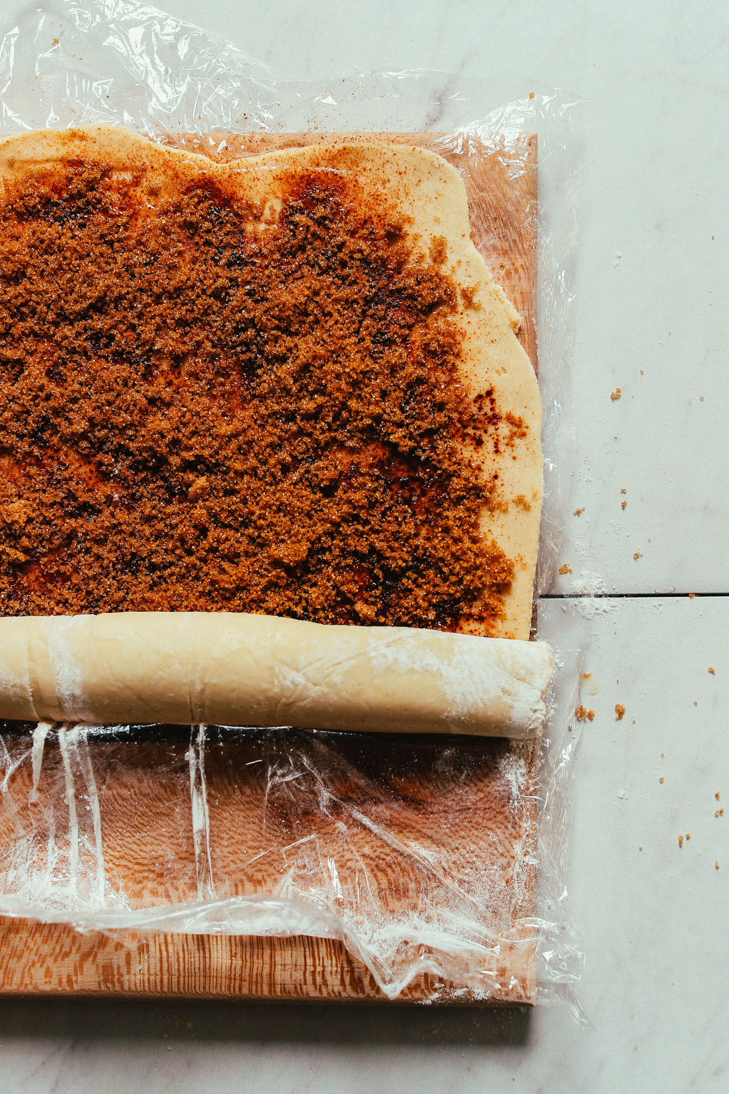 Rolling cinnamon roll dough for simple homemade Cinnamon Rolls