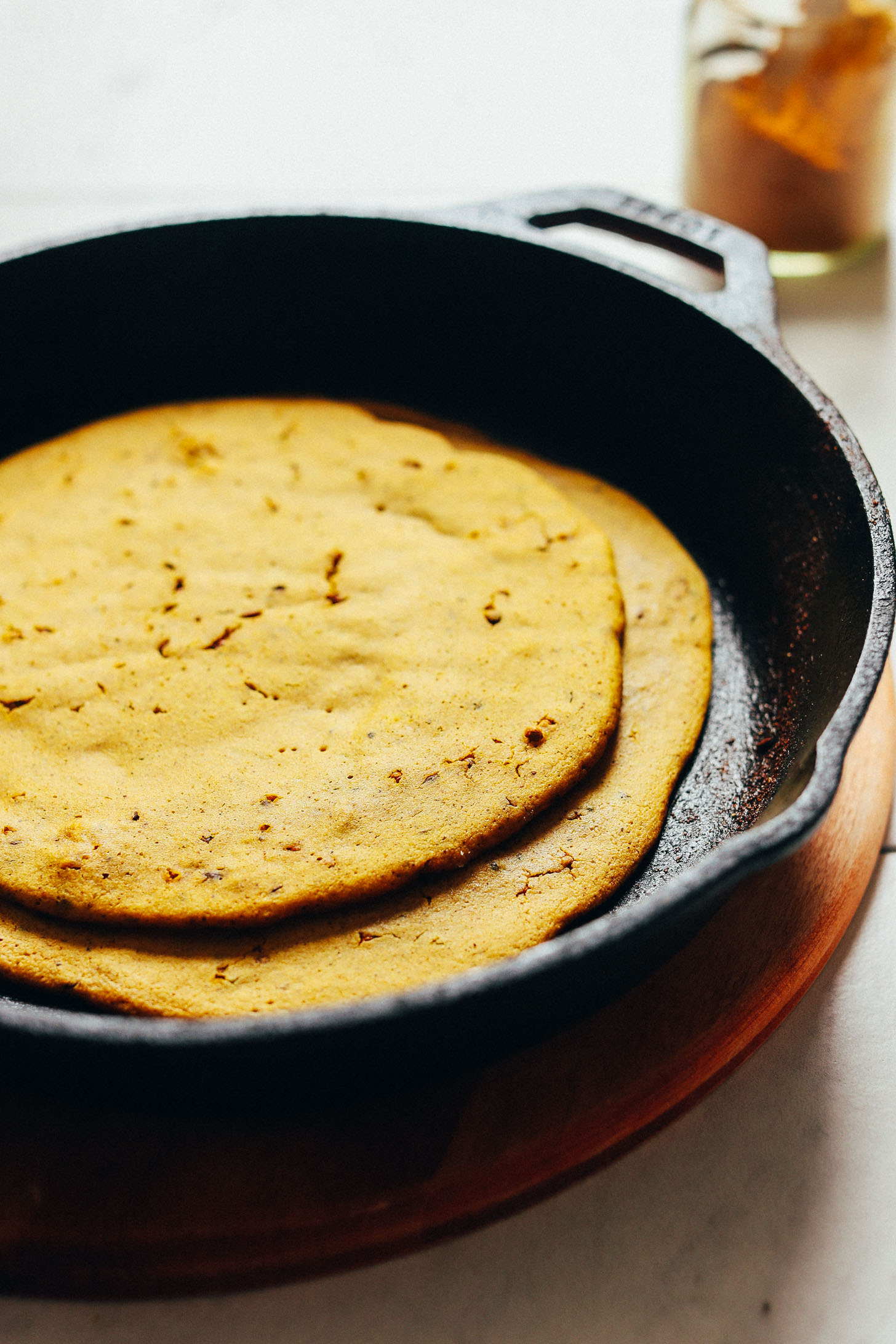 Freshly cooked Curried Socca bread resting in a skillet