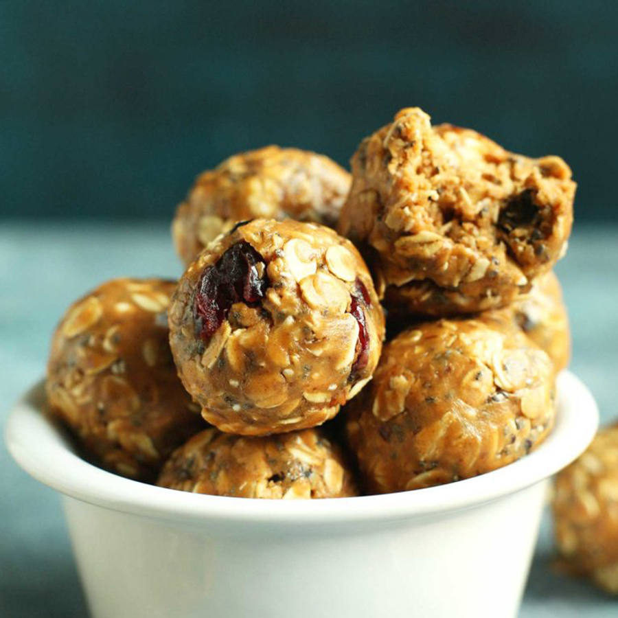 Bowl of Healthy PBJ Energy Bites that are perfect for taking on a road trip