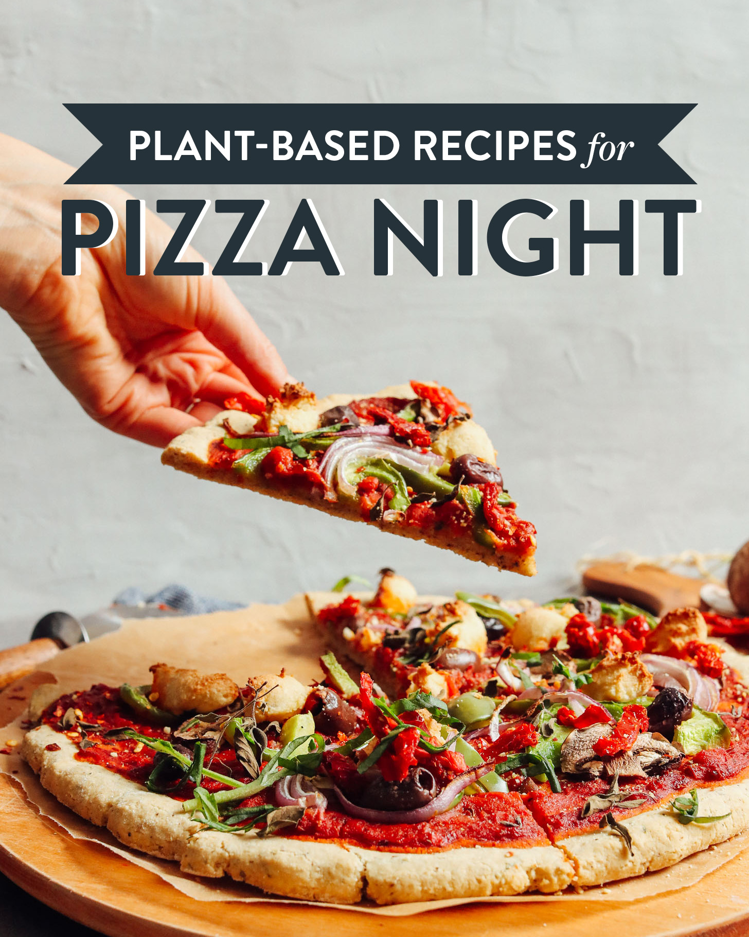 Picking up a slice of pizza for our Plant-Based Recipes for Pizza Night roundup