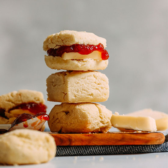 Spoonful of jam, slab of vegan butter, and stack of Vegan Gluten-Free Biscuits