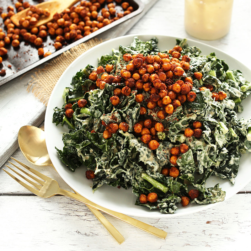 Plate of kale salad for our roundup of Plant-Based Recipes for Pizza Night