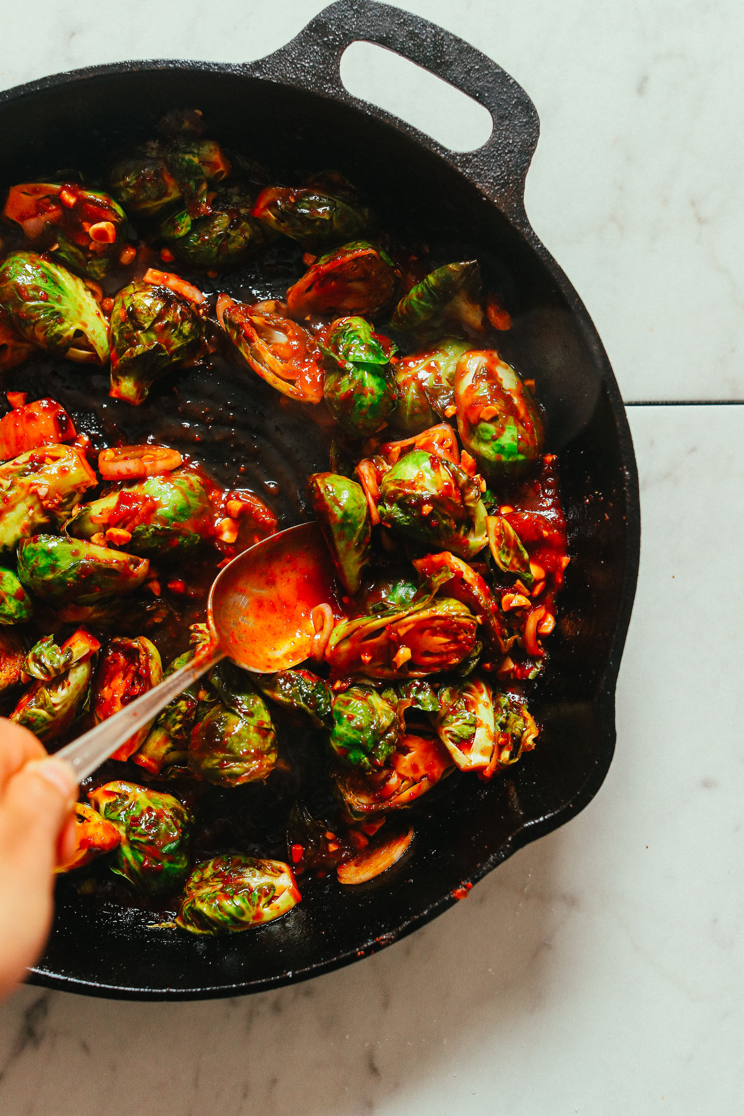 Cast-iron skillet filled with our vegan Gochujang Brussels Sprouts recipe