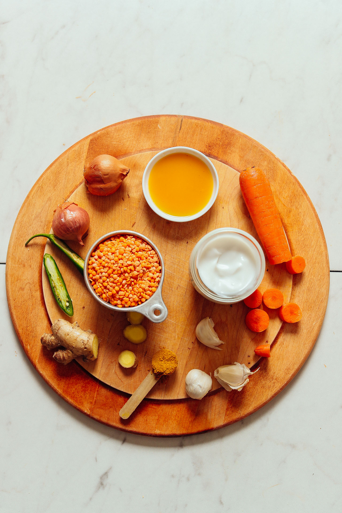 An overhead angle of the spices, vegetables, and ingredients required for golden curry lentil soup