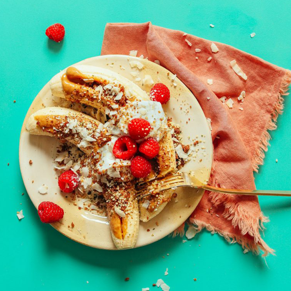 Fork resting on a raw banana split for our roundup of 30 Easy Plant-Based Summer Recipes