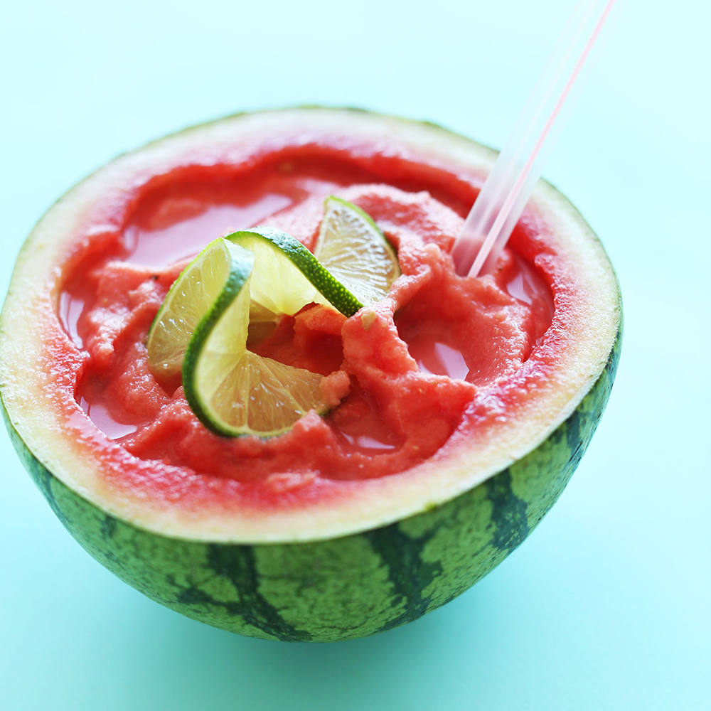 Halved watermelon rind filled with Watermelon Slushie for our Easy Plant-Based Summer Recipes