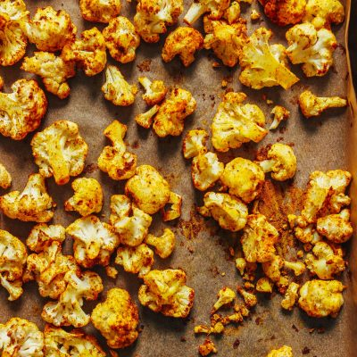 Parchment-lined baking sheet filled with Curry Roasted Cauliflower