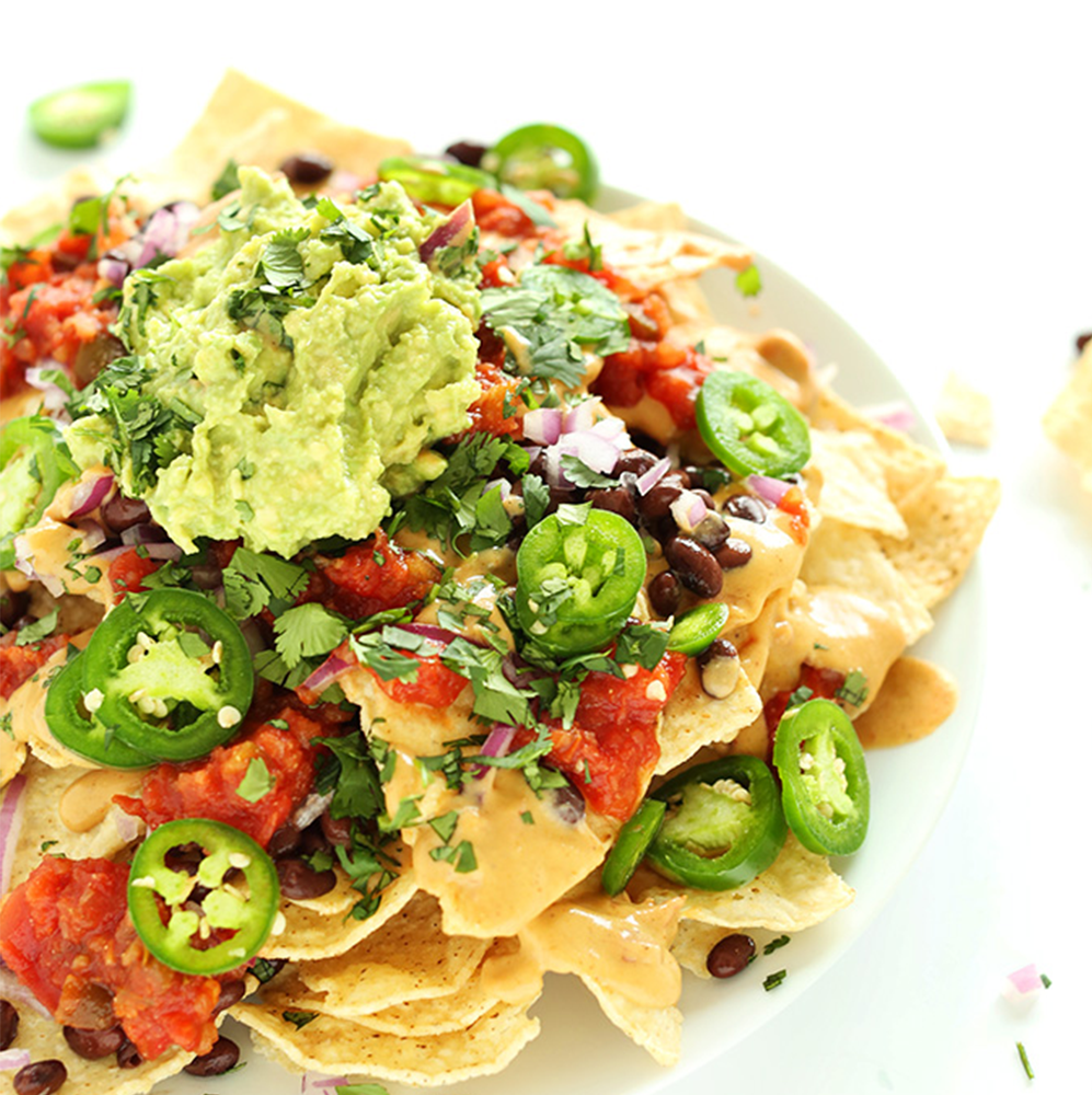 Plate of The Best Damn Vegan Nachos for our Easy Plant-Based Summer Recipes roundup