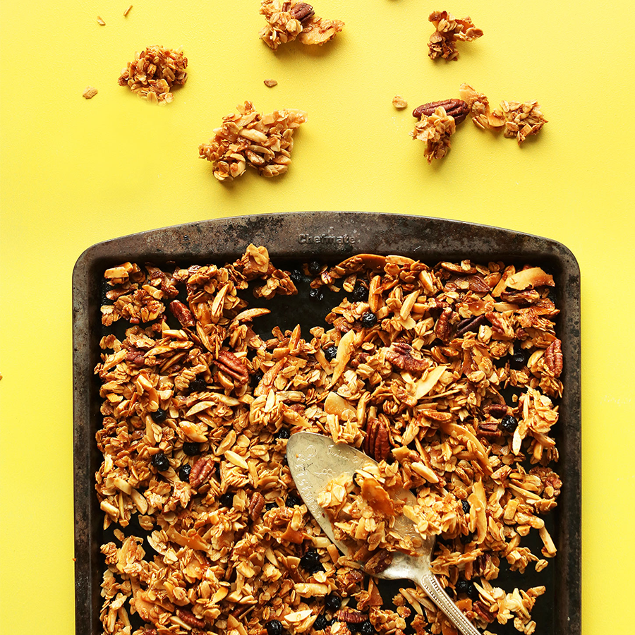 Vintage spoon on a tray of homemade Super Chunky Coconut Granola