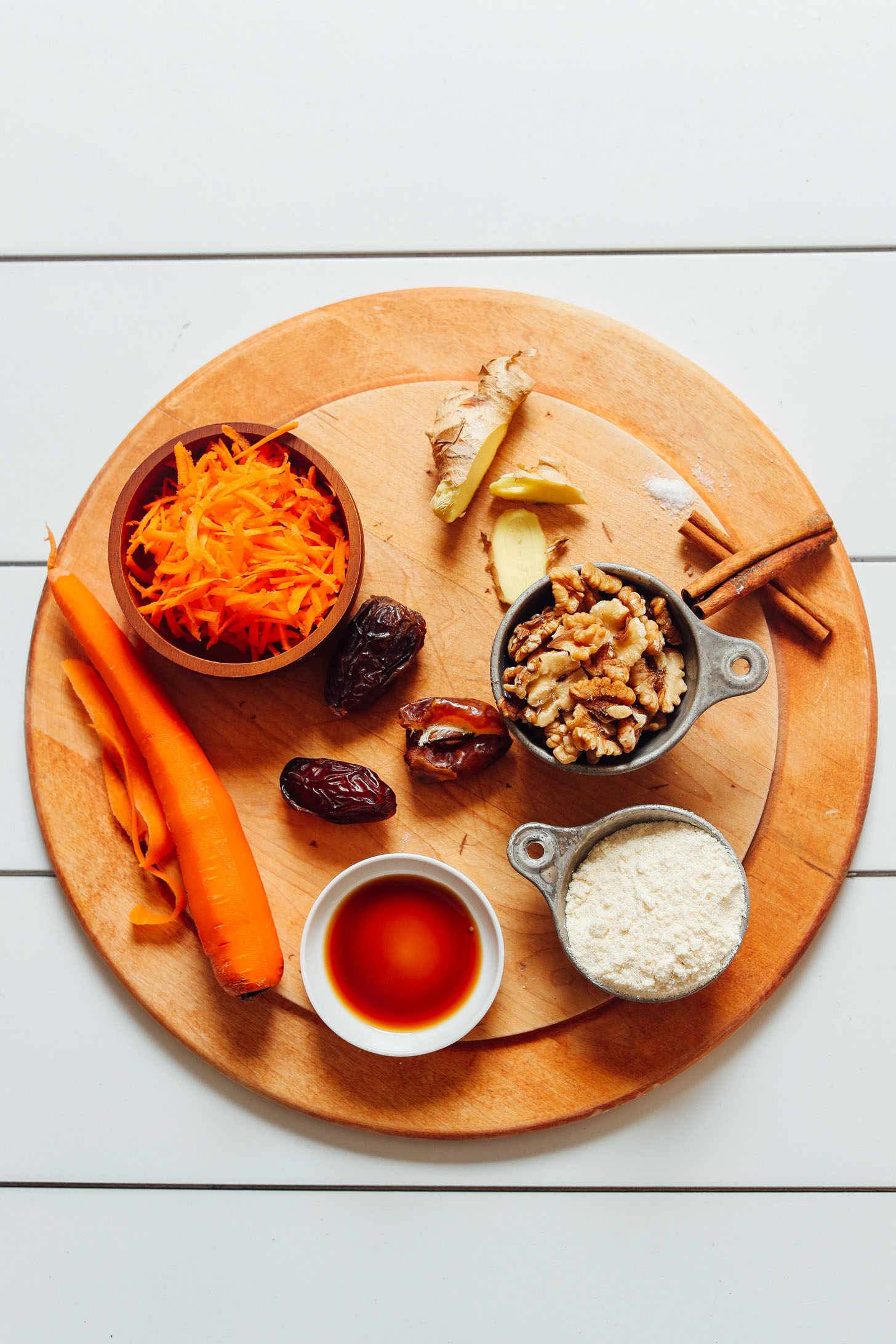 Wood cutting board with ingredients for making homemade Raw Vegan Carrot Cake