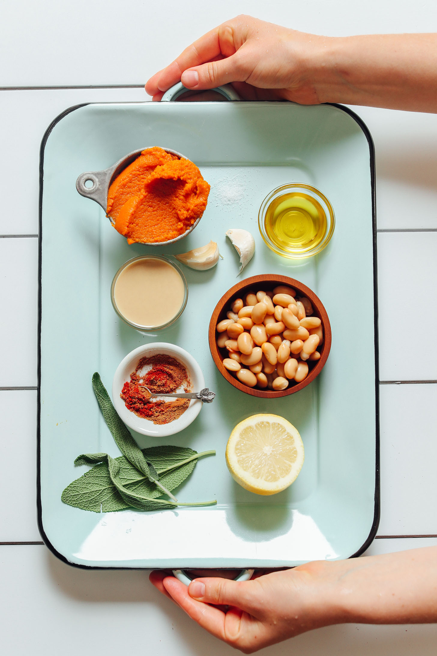 Tray filled with ingredients for making White Bean Pumpkin Hummus with Crispy Sage