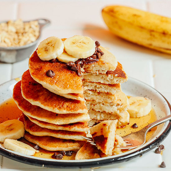 Stack of Banana Oat Pancakes with a slice removed